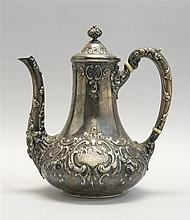 DOMINICK & HAFF AMERICAN SILVER COFFEEPOT In a repoussé floral and swag decoration. Ivory spacers in handle. Datemark for 1881. Mono...