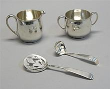 ARTHUR STONE STERLING SILVER CREAM AND SUGAR SET Together with a tomato server and cream ladle by Erickson of Gardner, Massachusetts...