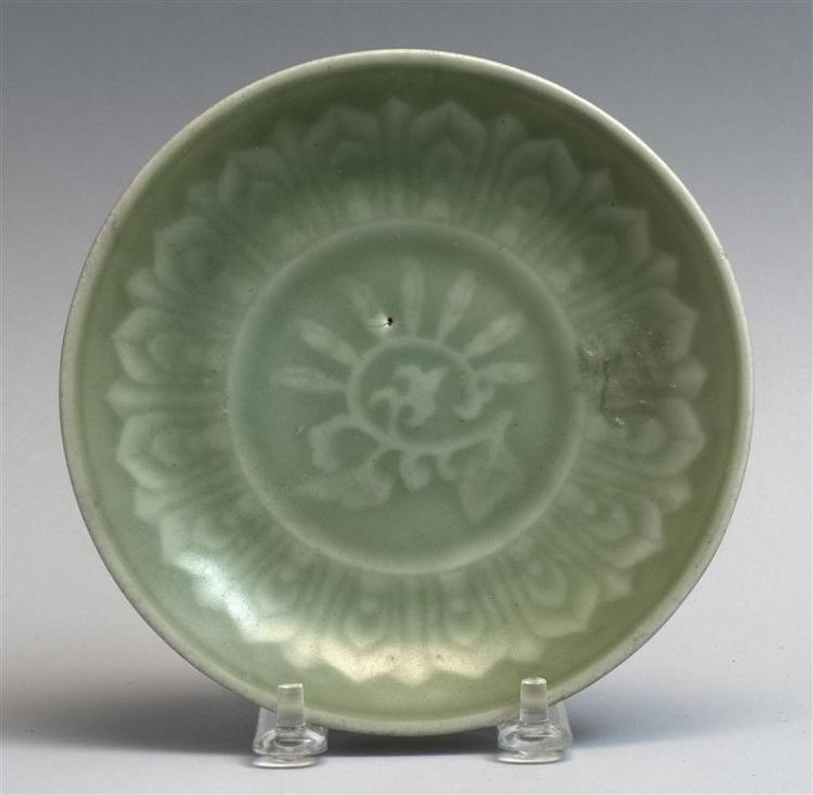 "CELADON PORCELAIN DISH With stylized floral design. Illegible seal mark on base. Diameter 5.75"" (14.7 cm)."