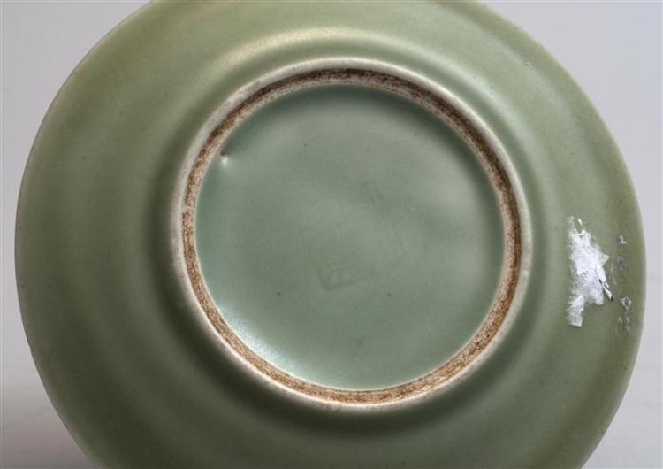 CELADON PORCELAIN DISH With stylized floral design. Illegible seal mark on base. Diameter 5.75
