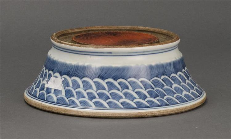 BLUE AND WHITE PORCELAIN INKSTONE In circular form with flared foot and wave-pattern decoration. Underglaze blue ruyi fungus mark on...