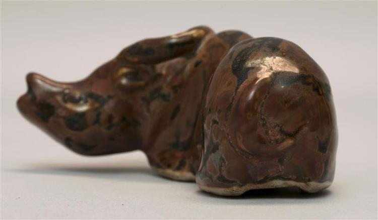 BROWN GLAZE PORCELAIN WATER DROPPER In the form of a reclining water buffalo. Length 3.7