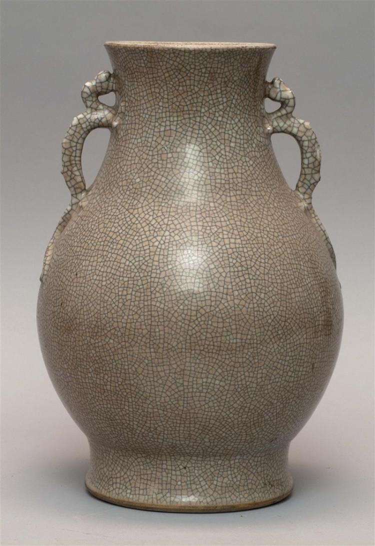 GE WARE PORCELAIN VASE In pear shape with relief dragon handles. Height 13.25