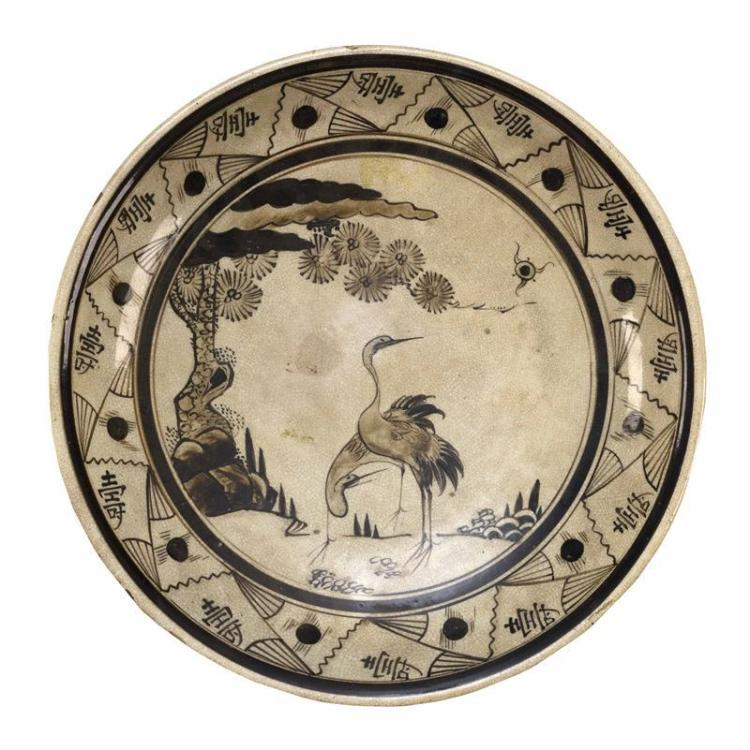 """CIZHOU POTTERY CHARGER With crane and pine tree design surrounded by fan and shou motifs. Diameter 15"""" (38 cm)."""