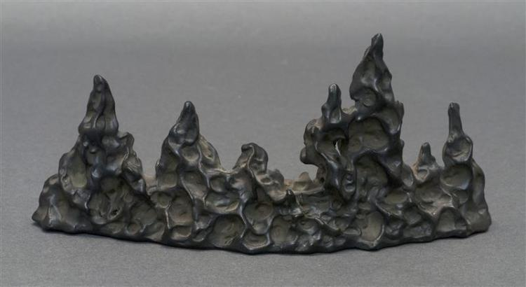 "PORCELAIN BRUSH REST In black lingbi scholar's rock form. Seal mark on base. Height 3.5"" (8.8 cm). Length 8"" (20.3 cm)."