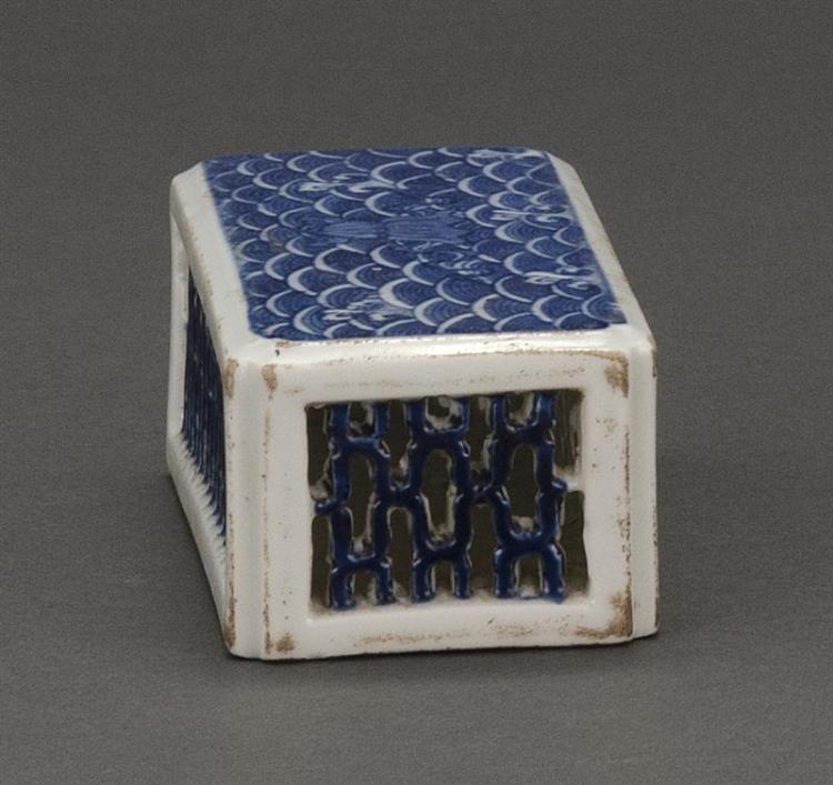 BLUE AND WHITE PORCELAIN SCROLL WEIGHT In rectangular form with latticework sides and wave-decorated top. Six-character Jiaqing mark...