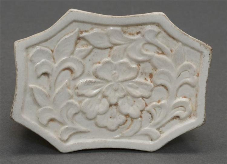 MINIATURE QINGBAI PORCELAIN PILLOW In modified rectangular form with relief peony design. Length 4