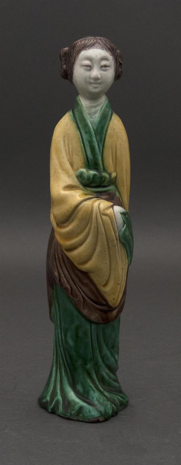 "SANCAI PORCELAIN FIGURE In the form of a woman holding a fan. Height 10"" (25.5 cm)."