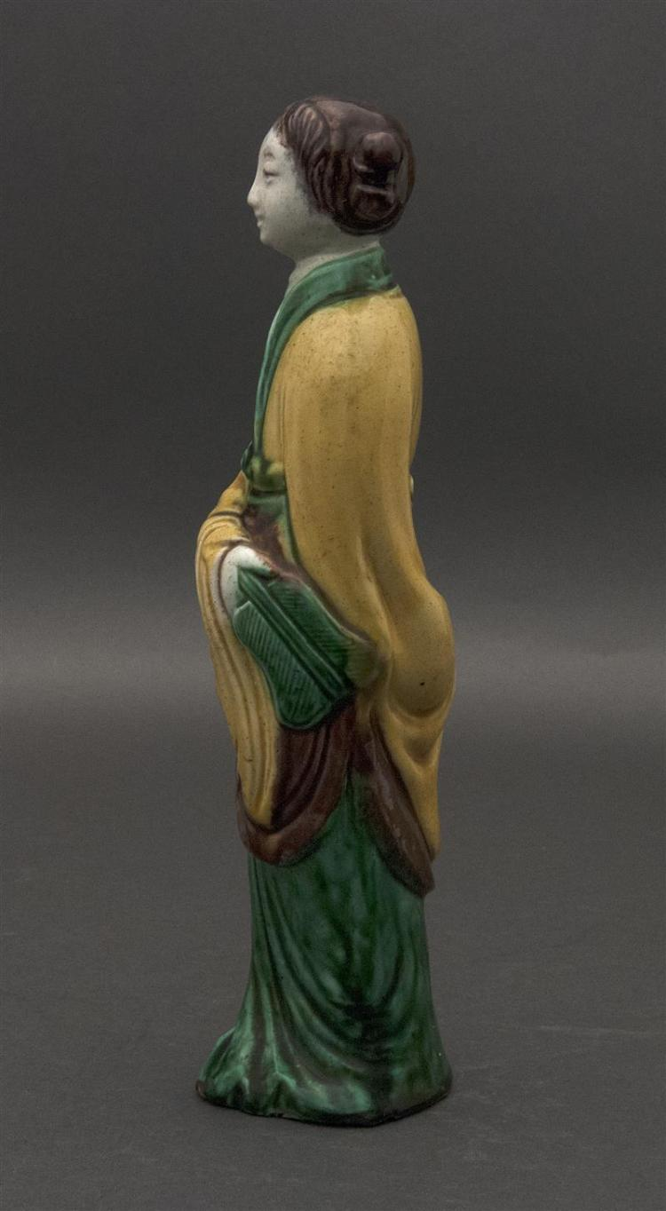 SANCAI PORCELAIN FIGURE In the form of a woman holding a fan. Height 10