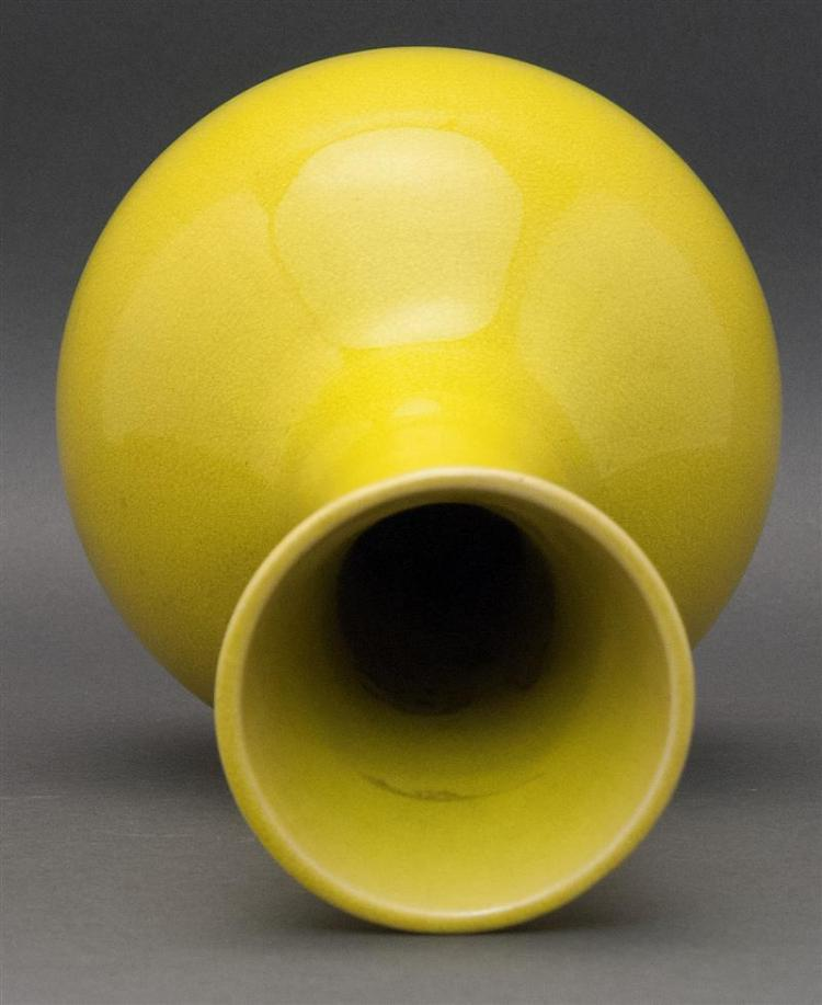 YELLOW GLAZE POTTERY VASE In ovoid form with trumpet mouth. Height 12.2