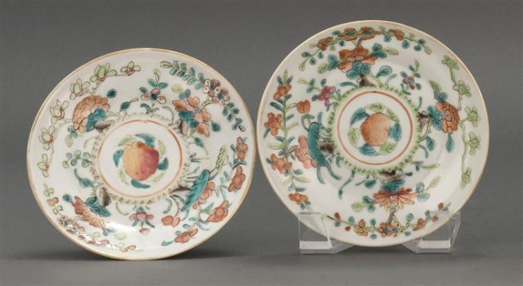 PAIR OF FAMILLE ROSE PORCELAIN TAZZE With peach, peony, and prunus design. Diameters 4.3