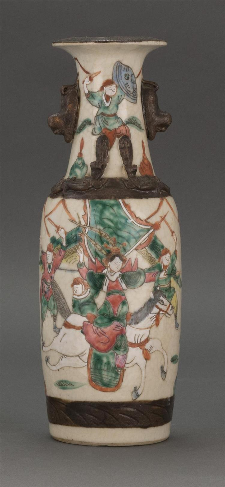 POLYCHROME PORCELAIN VASE With decoration of warriors in a landscape. Height 11.5