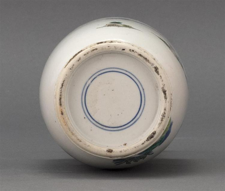 UNDERGLAZE BLUE AND ENAMEL-DECORATED PORCELAIN VASE In rouleau form with decoration of ladies in a garden. Double ring mark on base....