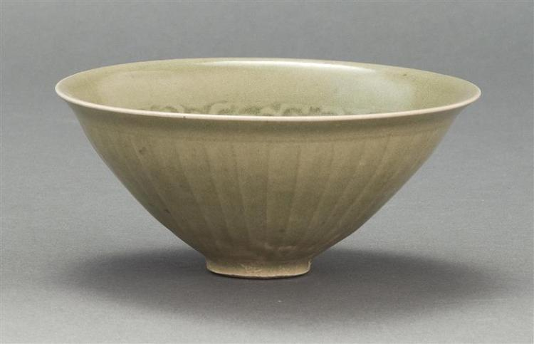 "LONGQUAN-STYLE CELADON BOWL In conical form with carved lotus design. Diameter 5.4"" (13.7 cm)."