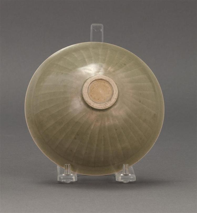 LONGQUAN-STYLE CELADON BOWL In conical form with carved lotus design. Diameter 5.4