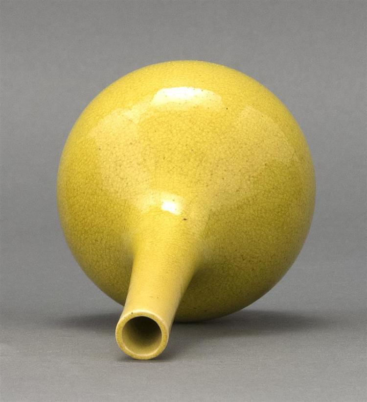 YELLOW GLAZE PORCELAIN BOTTLE VASE In teardrop form. Height 6.8