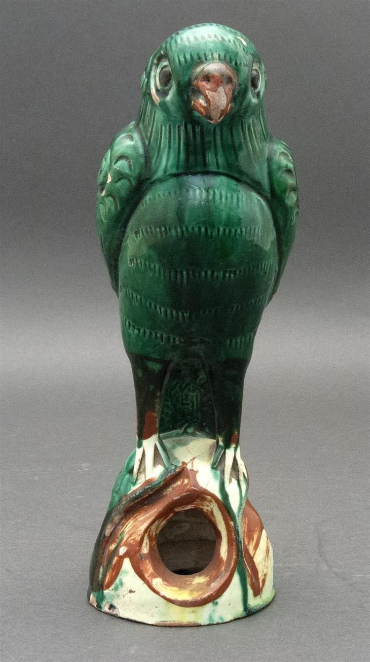"GREEN GLAZE POTTERY PARROT FIGURE Depicted perched on an openwork base. Height 9"" (23 cm)."
