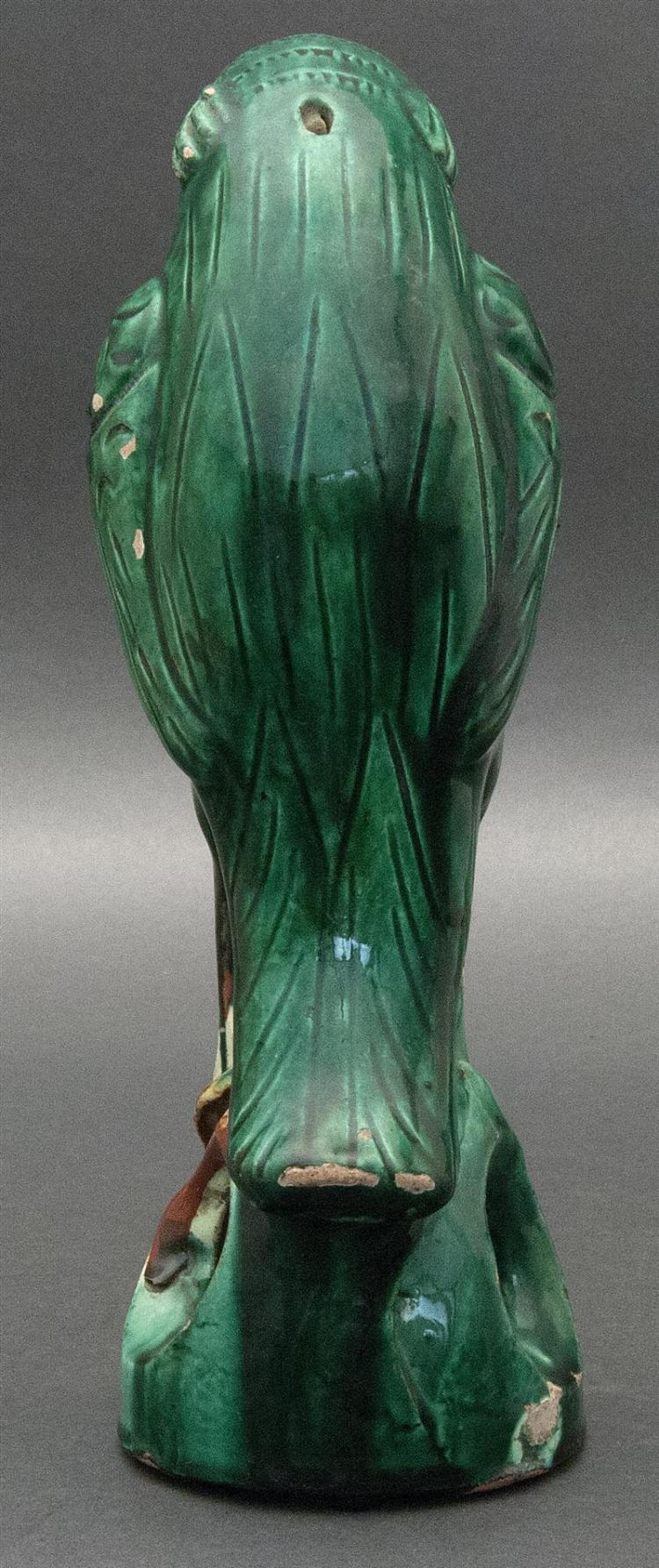 GREEN GLAZE POTTERY PARROT FIGURE Depicted perched on an openwork base. Height 9