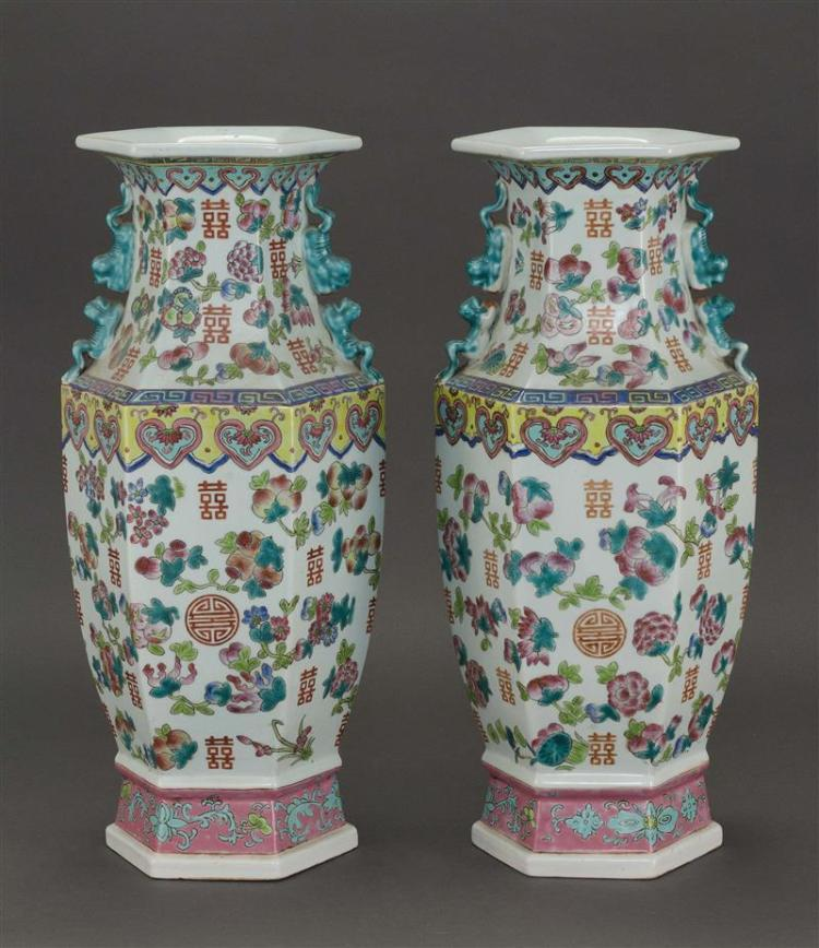 """PAIR OF FAMILLE ROSE PORCELAIN VASES In hexagonal form with fruit and shou design. Heights 17.5"""" (44.3 cm)."""