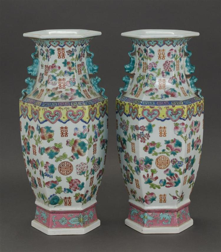 PAIR OF FAMILLE ROSE PORCELAIN VASES In hexagonal form with fruit and shou design. Heights 17.5