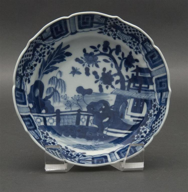 BLUE AND WHITE PORCELAIN BOWL In flower form with central courtyard landscape decoration and stylized flower basket and key-fret bor...