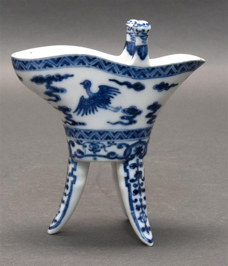 "BLUE AND WHITE PORCELAIN JUE With phoenix and cloud design with floral tri-foot base. Four-character mark on base. Height 5"" (12.7 cm)."