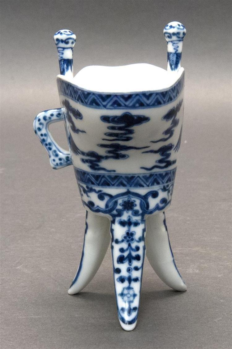 BLUE AND WHITE PORCELAIN JUE With phoenix and cloud design with floral tri-foot base. Four-character mark on base. Height 5