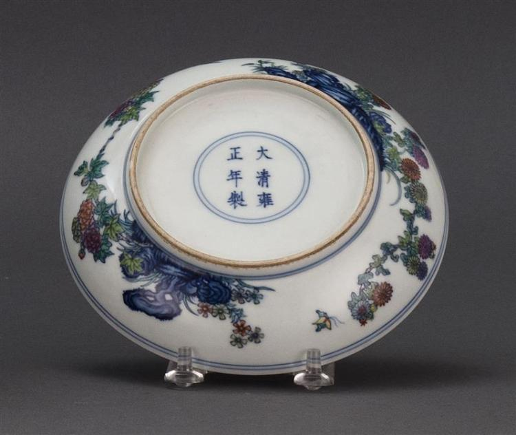 DOUCAI PORCELAIN DISH With butterfly and flower design. Six-character Yongzheng mark on base. Diameter 6.2