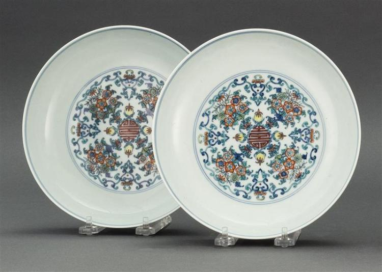 "PAIR OF DOUCAI PORCELAIN DISHES With flower and shou design. Six-character Yongzheng mark on base. Diameters 7.8"" (20 cm)."