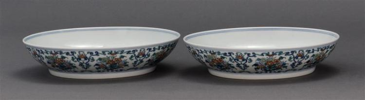 PAIR OF DOUCAI PORCELAIN DISHES With flower and shou design. Six-character Yongzheng mark on base. Diameters 7.8