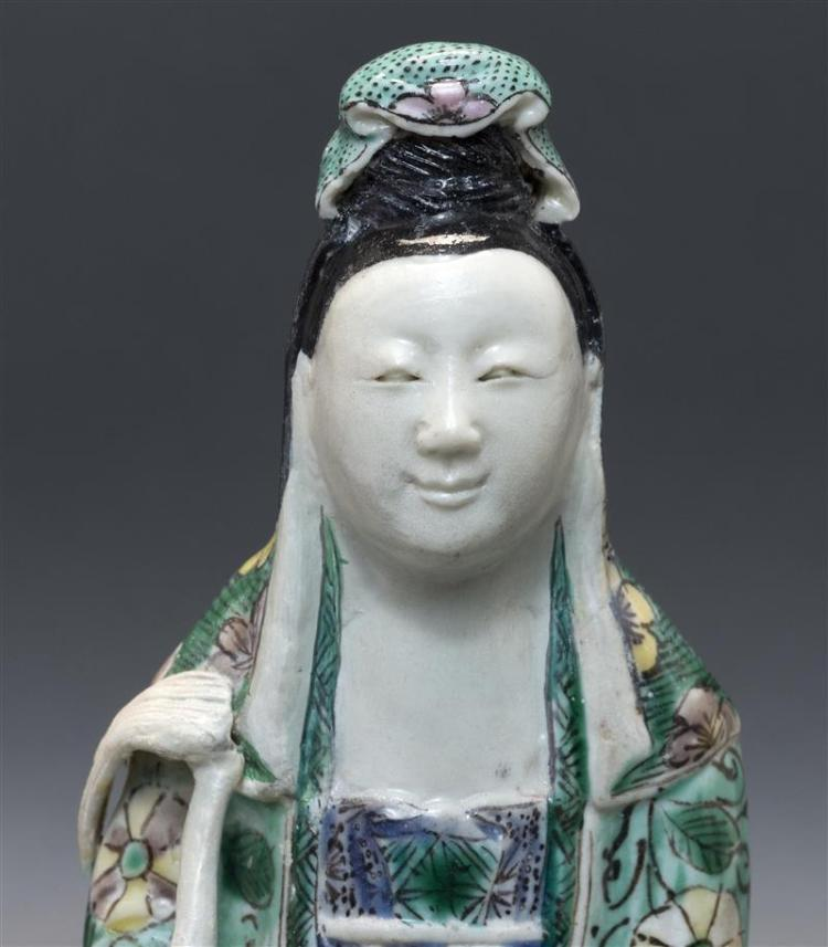 FAMILLE VERTE PORCELAIN FIGURE GROUP In the form of Guanyin seated on a lotus throne with two attendants, all on a rectangular platf...