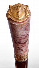 CANNE, le pommeau milord  en agate rouge, pastille de bronze doré à tête à l'ant