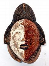 masque Punu ou Tshogo, Gabon, bicolore, utilisé lors des cérémonies nocturnes de