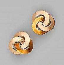 Paire de CLIPS d'oreilles trois ors 14 k. formés de trois disques entrelacés. Sy
