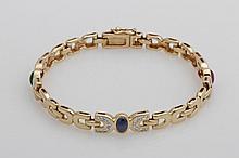 Armband. Besetzt mit einem Rubin, Safir und Smaragd, sowie Diam.-Brillanten zus.ca. 0,50ct, TW/vsi,