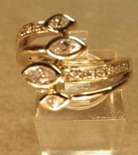 Double snake ring with diamonds