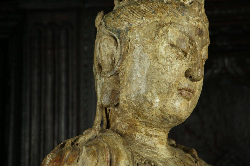 Le Boddhisattva de la Compassion , Kwan Yin « Avalokitésvara » assis