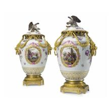 A Fine Pair of Gilt Bronze Mounted Painted Porcelain Vases and Eagle Finial Covers