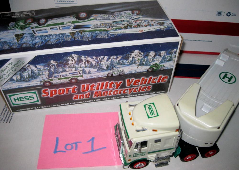 NIB Hess TOY TRUCK Sport Utility Vehicle with 2 Motorcycles 1964-2004 40th Anniversary and a  HESS Car Hauler