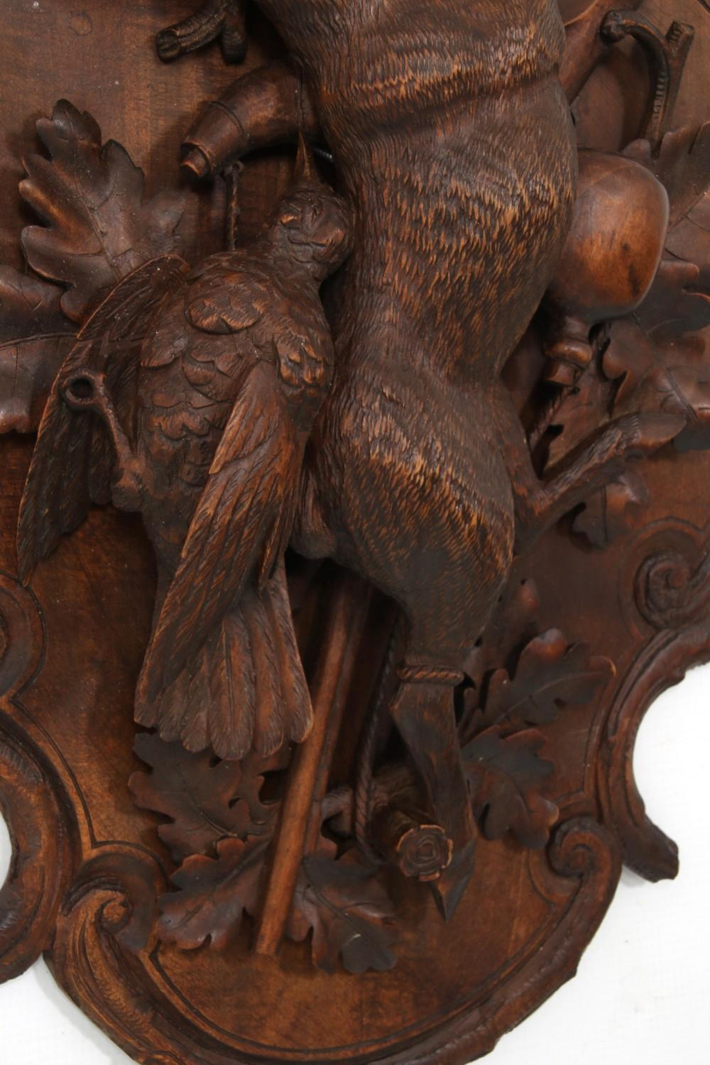 Pair of Black Forest Carved Wall Plaques