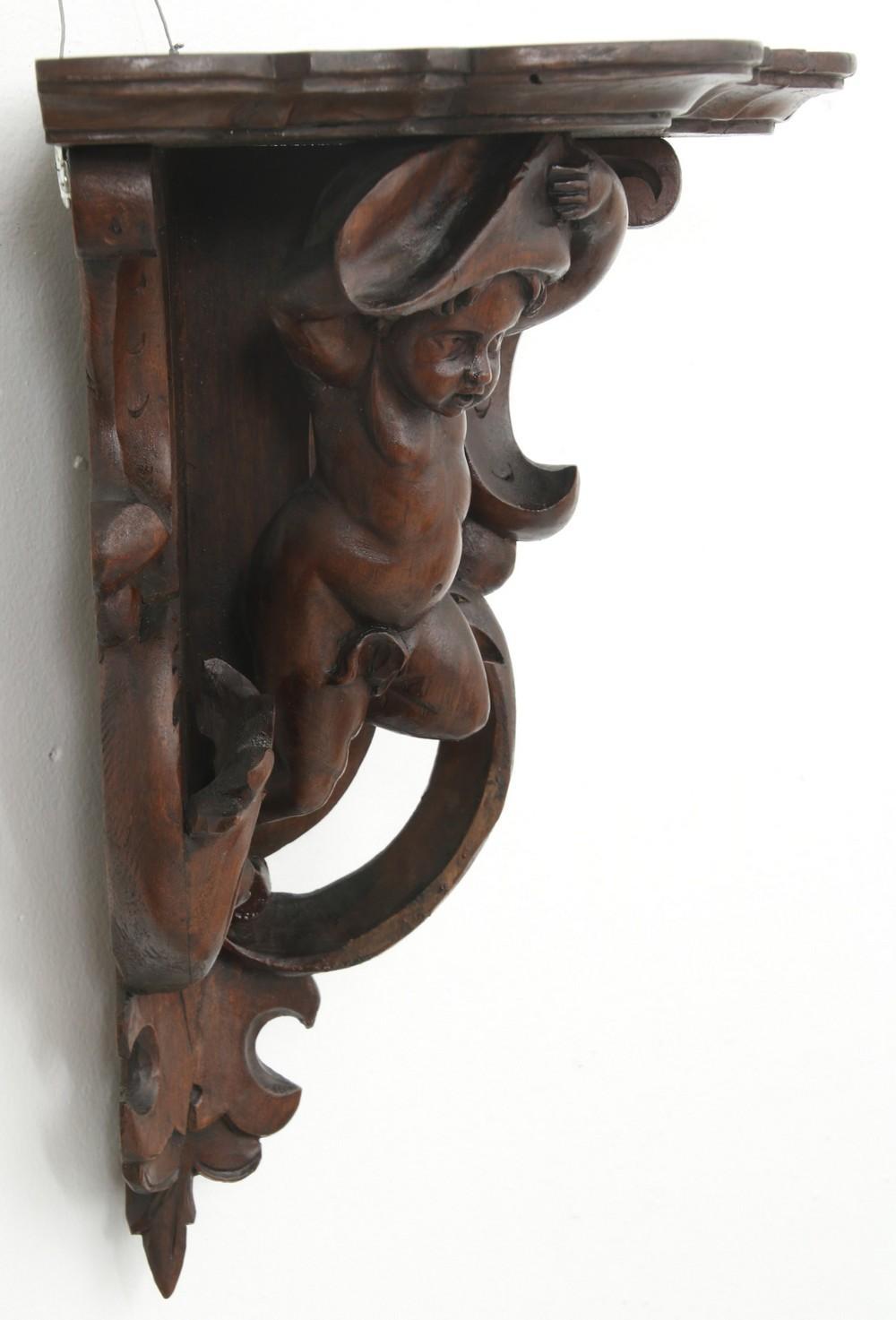 Pair of Black Forest Carved Corner Shelves