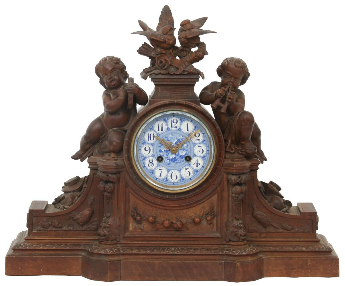 French Figural Carved Walnut Mantel Clock