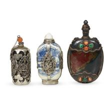 A group of three Chinese silver-embellished snuff bottles,