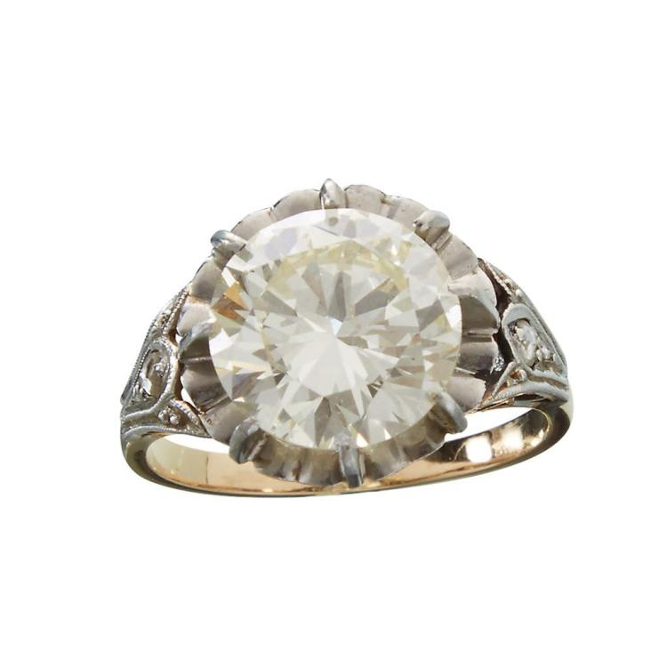 A diamond, platinum and eighteen karat gold ring,