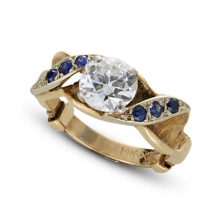 A diamond, synthetic sapphire and fourteen karat gold ring,
