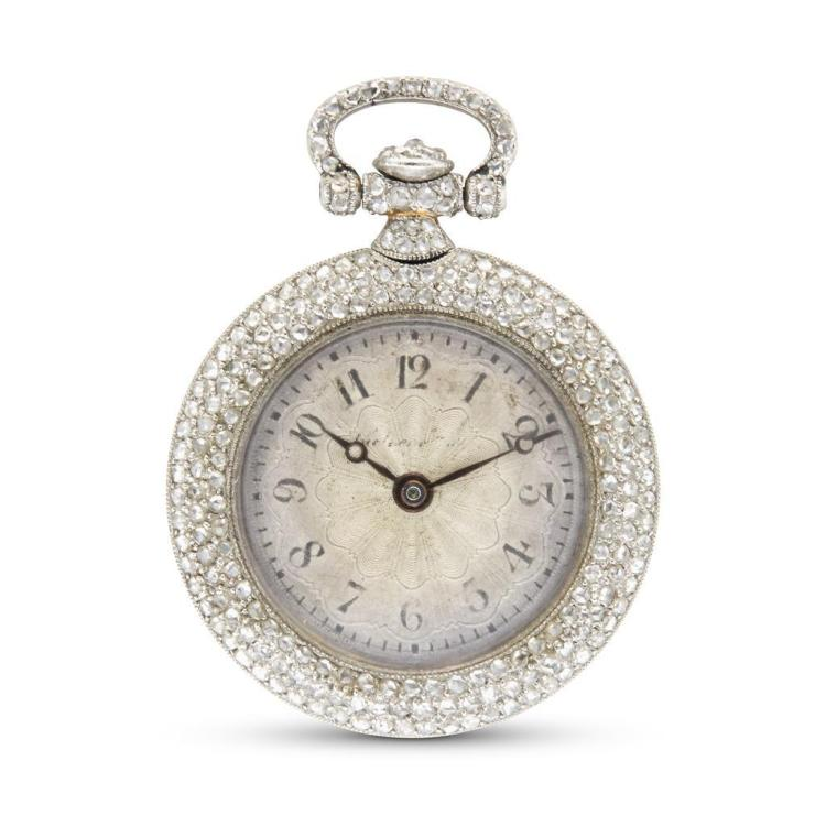 A diamond and platinum pendant watch,