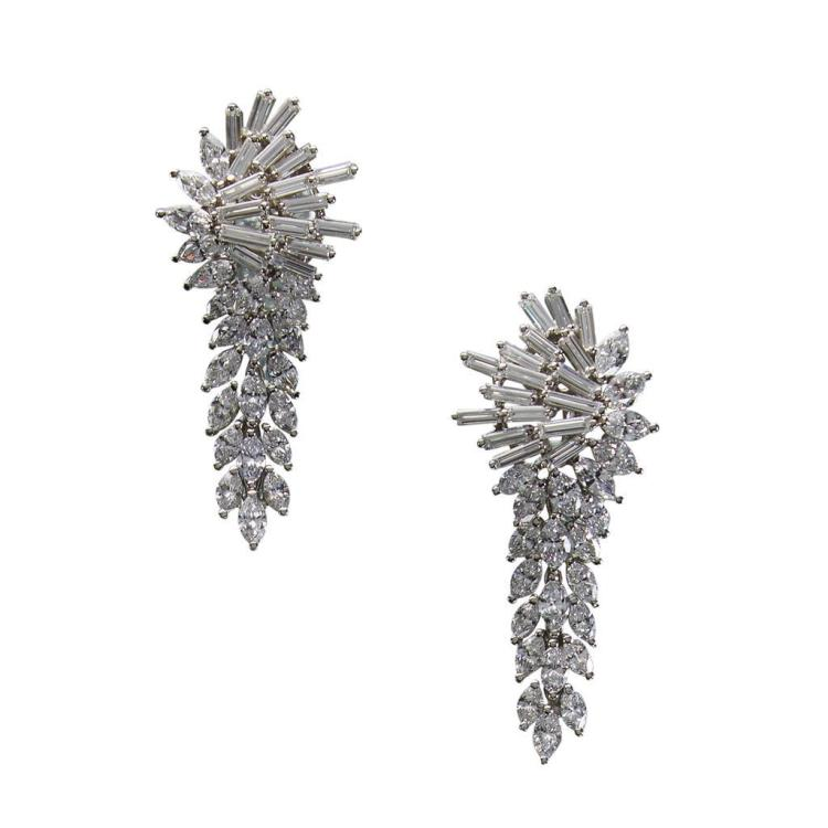 A pair of diamond and platinum day-night earrings,