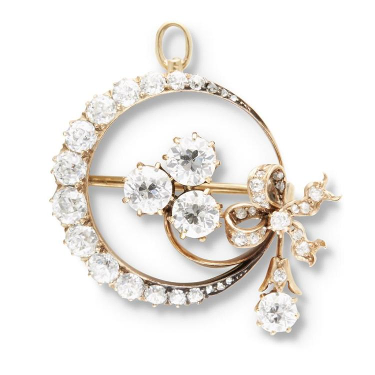 A Belle Époque diamond and fourteen karat gold pendant-brooch, circa 1900