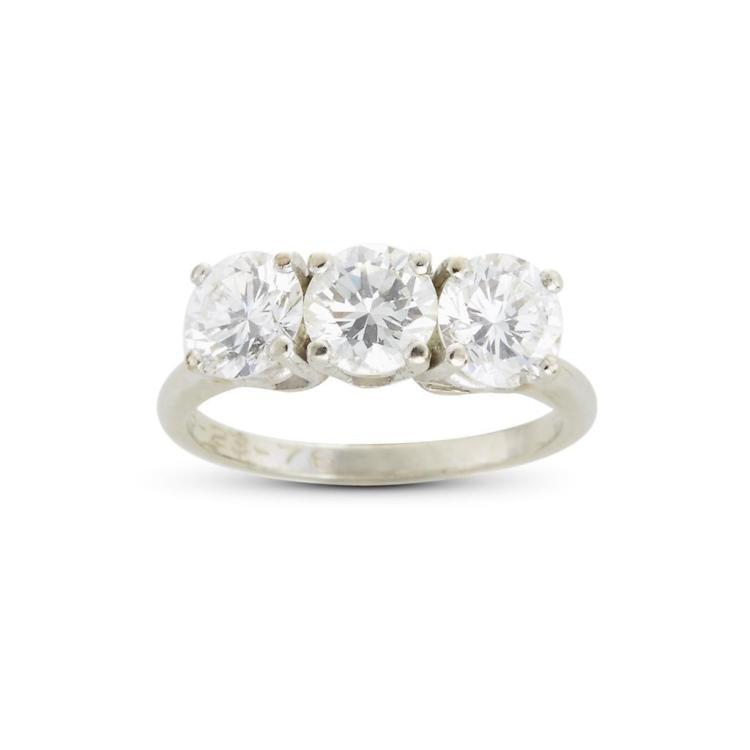 A diamond and fourteen karat gold three-stone ring,