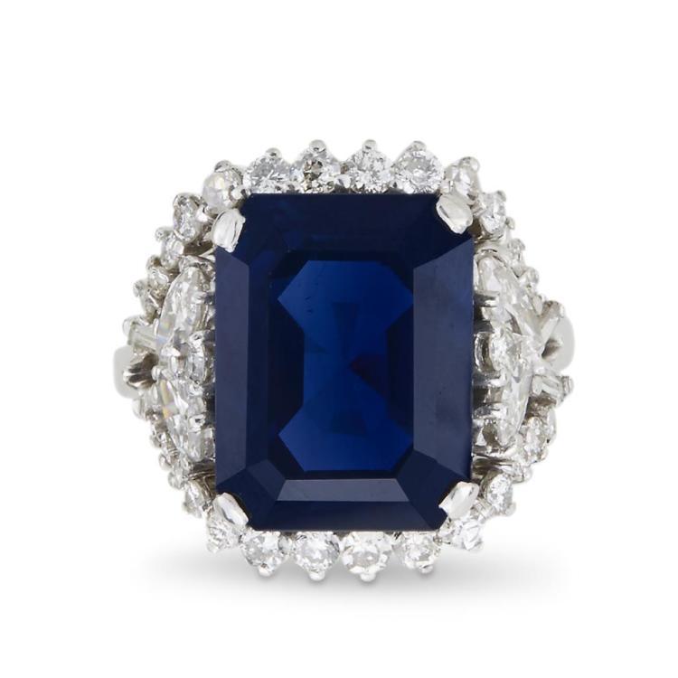 A sapphire, diamond and fourteen karat white gold ring,